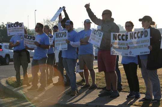 New Castle County police officers protested outside the Christiana Hilton Friday morning.  They have been working for about six months without a contract.  Inside the hotel, New Castle County Executive Matt Meyer was giving a speech.