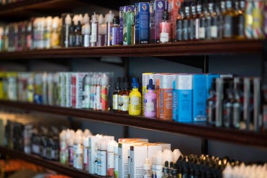 Flavored e-liquids line the shelves at Vape Escape in Wilmington.