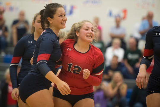 Newark Charter's Emma Ueltzhoffer (18) and McKenna Ritchie (12) celebrate a point during a 3-0 sweep of Archmere on Sept. 26. The Patriots (14-1) have earned the top seed in the DIAA Volleyball Tournament, which begins Thursday.