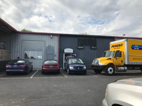Vans outside of Allure Nightclub pack up equipment.