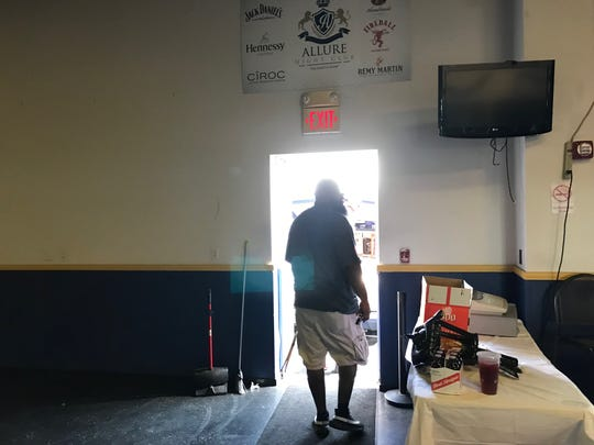 Allure Nightclub owner leaving out of club.