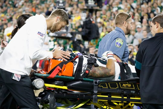 Philadelphia Eagles cornerback Avonte Maddox is carted off the field after being injured on a play during the second half of an NFL football game against the Green Bay Packers Thursday, Sept. 26, 2019, in Green Bay, Wis. Philadelphia won 34-27.