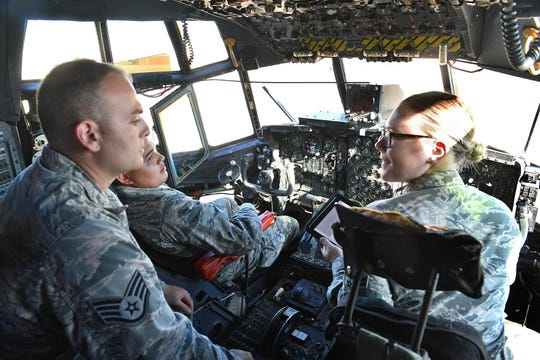 SSgt. David Schutte, left, instructs AB Ricky Cruz and A1C Rebecca Clevenger to prepare the aircraft for ground power on the flight deck of a C-130 Hercules at Sheppard Air Fore Base. SAFB will host the Guardians of Freedom Open House & Air Show this Oct. 26-27.