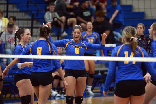 Maysville celebrates a point on Thursday against West Muskingum in Newton Township.