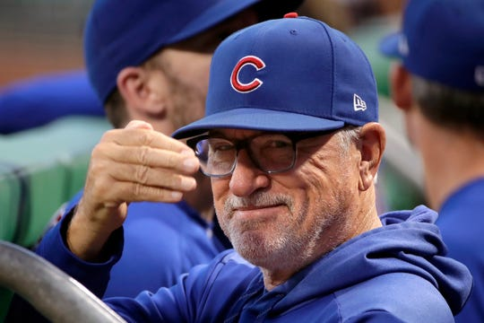 Chicago Cubs manager Joe Maddon acknowledges a fan before the team's baseball game against the Pittsburgh Pirates in Pittsburgh.