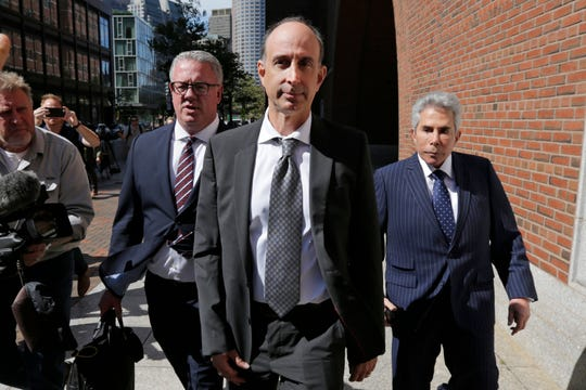 California businessman Stephen Semprevivo departs after his sentencing hearing at federal court in Boston, Thursday, Sept. 26, 2019. Semprevivo who plead guilty to charges that he bribed the Georgetown tennis coach to get his son admitted to the school during May 2019, was sentenced Thursday to four months in prison. (AP Photo/Charles Krupa) ORG XMIT: MACK106