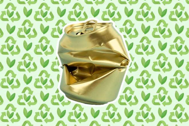 Crumpled gold can on a patterned background.