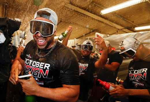 September 25: Designated hitter Nelson Cruz celebrates with teammates at the club after the Minnesota Twins won the AL Central Division title.