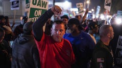 Tommy Wolikow throws his fist in the air in solidarity while standing with other UAW members as workers leave Flint Assembly early Sept. 16, 2019 while taking part in a national strike against General Motors after stalled contract negotiations with General Motors. The workers are on the first national UAW strikesince 2007.