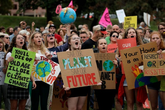 Climate protesters demonstrate Friday, Sept. 20, 2019, in Kansas City, Missouri.