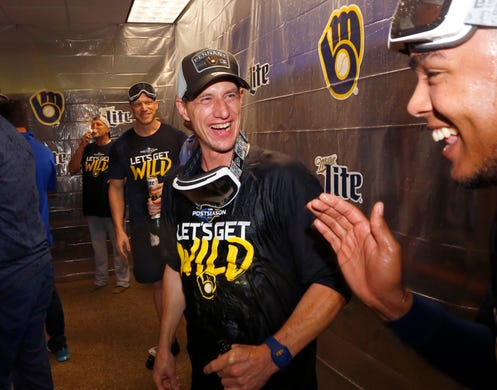 Brewer manager Craig Counsell celebrates at the club.