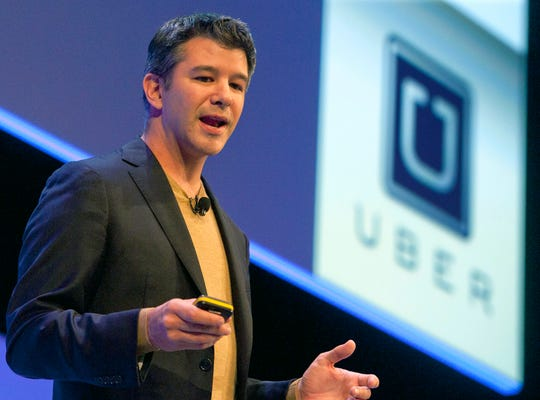epa06040302 (FILE) Travis Kalanick, founder and CEO of Uber, delivers a speech at the Institute of Directors Convention at the Royal Albert Hall, Central London, Britain, 03 October 2014 (reissued 21 June 2017). According to reports on 21 June 2017, Kalanick has resigned as CEO of Uber amid pressure from shareholders.  EPA/WILL OLIVER ORG XMIT: FIL
