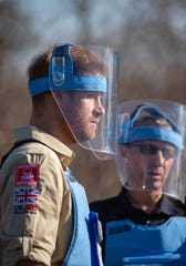 Prince Harry walks through a minefield in Dirico, Angola, during a visit to see the work of landmine clearance charity the HALO Trust, on day five of the royal tour of Africa.