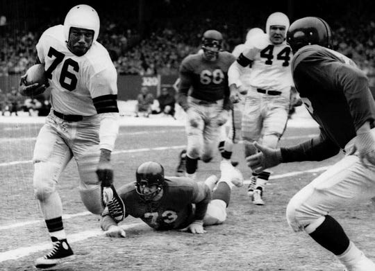 Marion Motley, left, is an NFL champion and a two-time First Team All-Pro. He was the second African American to be inducted in the Pro Football Hall of Fame.