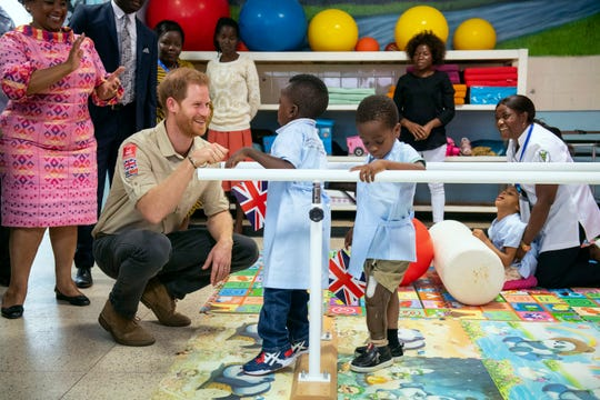 Prince Harry meets Barnaby Jose Mar, 6, as he visits the Princess Diana Orthopaedic Centre in Huambo, Angola, on Sept. 27, 2019.
