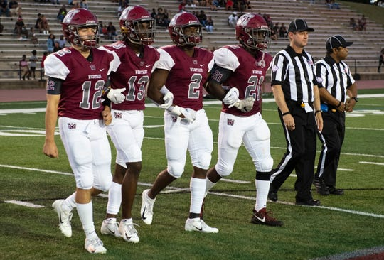 Westside captains walks onto the field for the coin toss before the game against T.L. Hanna at Westside Friday, Sept. 27, 2019.