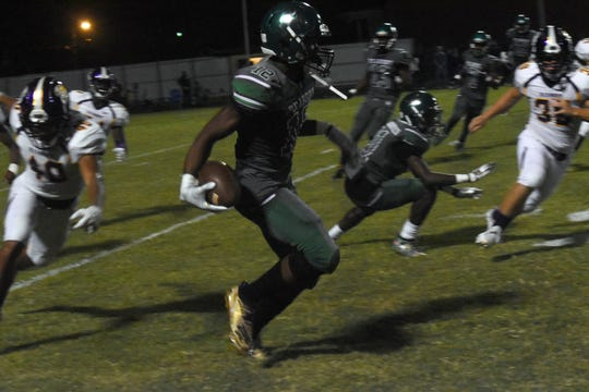 Peabody's Thomas Miles (12) runs for a first down after catching a pass against Alexandria Senior High School Sept. 27.