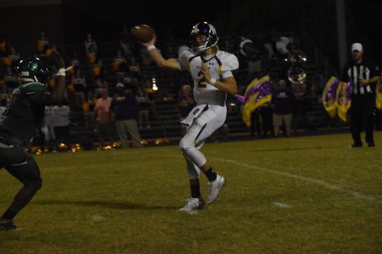 Alexandria Senior High quarterback Judd Barton (2) looks to pass against Peabody during a game last season.