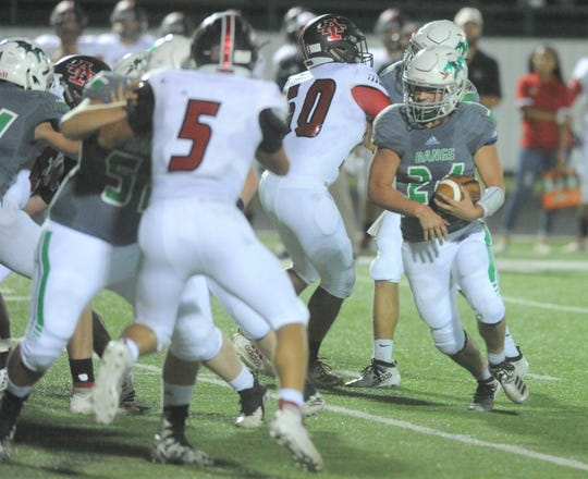 Bangs running back Ethan Sanchez, right, carries the ball during the first quarter against Anson on Friday, Sept. 27, 2019, at Dragon Memorial Stadium in Bangs.