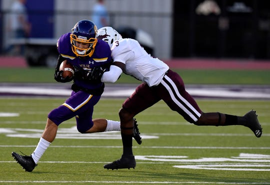 Wylie wide receiver Creed Cooper is tackled by Brownwood's Khyren Deal during Friday's game at Bulldog Stadium in Abilene Sept. 27, 2019.The Lions took a 26-0 lead into halftime.