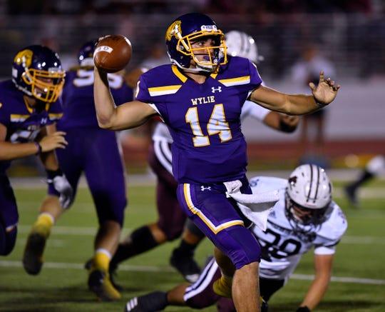Wylie quarterback Jaxon Hansen throws a pass during Friday's game against Brownwood at Bulldog Stadium in Abilene Sept. 27, 2019. Final score was 33-0, Brownwood.