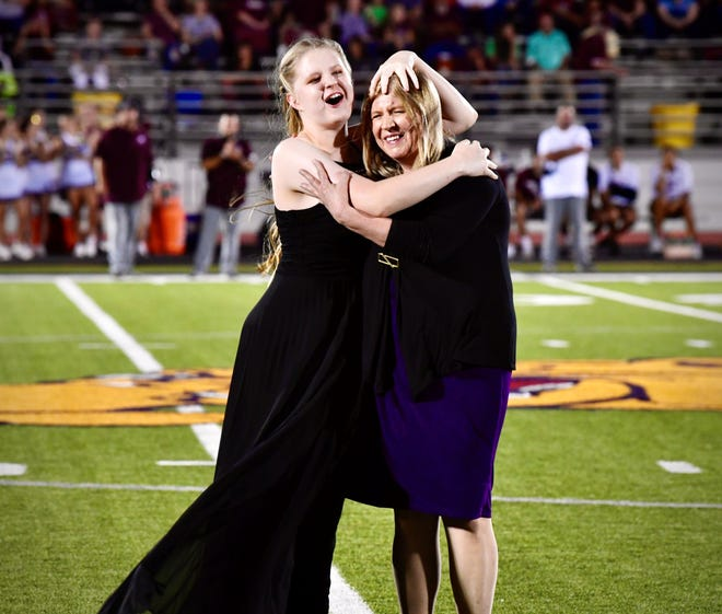 An excited Christina Hancock jumps in her mother Sharon's arms after being announced as Wylie High School's 2019 homecoming queen Friday night at Bulldog Stadium.