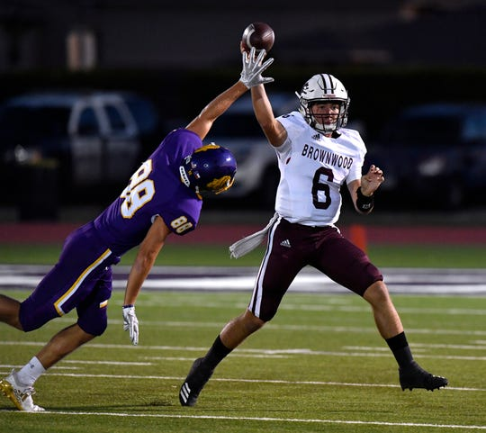 Wylie linebacker Brodey Baker tries blocking the pass of Brownwood quarterback Andrew Huff during Friday's game at Bulldog Stadium in Abilene Sept. 27, 2019. Final score was 33-0, Brownwood.
