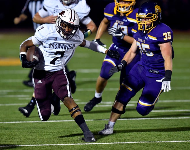 Brownwood's Royshad Henderson is chased by Wylie linebacker Dax Morris during Friday's game at Bulldog Stadium in Abilene Sept. 27, 2019. Final score was 33-0, Brownwood.