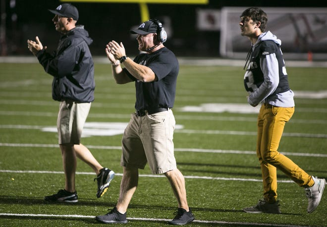 Brandon Allen (center) resigned Tuesday after four years as North Buncombe head coach.