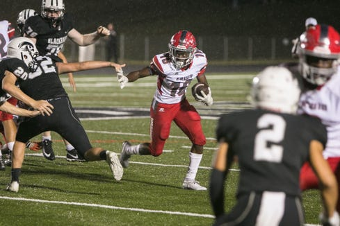 Erwin's Monty Williams runs the ball as Erwin faces off against North Buncombe on Sept. 27, 2019, at North Buncombe.  Erwin took the win with a final score of 21-20.