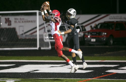 Erwin's Shy Stillwell intercepts a pass intended for North Buncombe's Christian King as the teams face off on Sept. 27, 2019, at North Buncombe. Erwin took the win with a final score of 21-20.