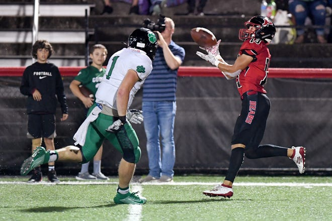 Pisgah's Ryan Reynolds catches a pass ahead of Mountain Heritage's Cole Shehan during their game at Memorial Stadium in Canton on Sept. 27, 2019.