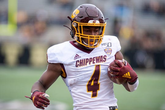Central Michigan running back Kobe Lewis (4) scores the first touchdown for Central in the fourth quarter of the Battle for the Cannon against Western Michigan on Saturday, Sept. 28, 2019 at Waldo Stadium in Kalamazoo, Mich.