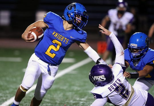 North Kitsap's Colton Bower makes a grab for Bremerton quarterback Kelo Logova during their game at Bremerton Memorial Stadium on Friday, Sept. 27, 2019.