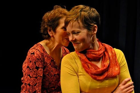 Cynthia Lair (left) whispers something — probably something funny — to Bhama Roget during a performance by The Edge Improv troupe, who make their monthly stop at Bainbridge Performing Arts at 7:30 p.m. Oct. 4.