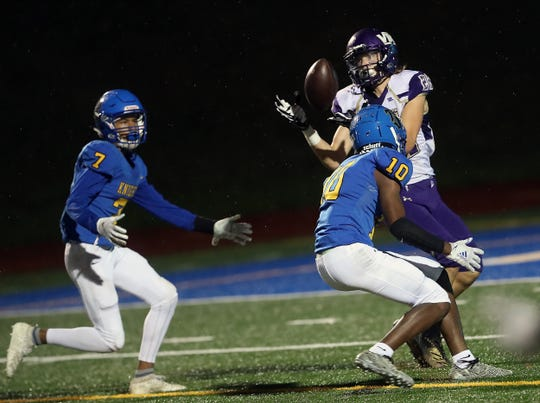 North Kitsap's Erik Burchill makes a catch in the end zone for a touchdown after the ball was tipped by Bremerton's Kanye Taylor (10) at Bremerton Memorial Stadium on Friday, Sept. 27, 2019.