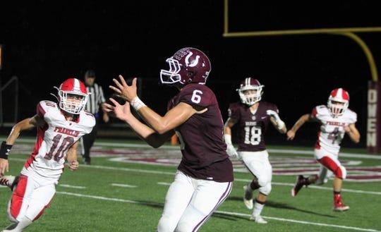 Owen junior Myles Tate looks in a 23-yard touchdown reception against Franklin.