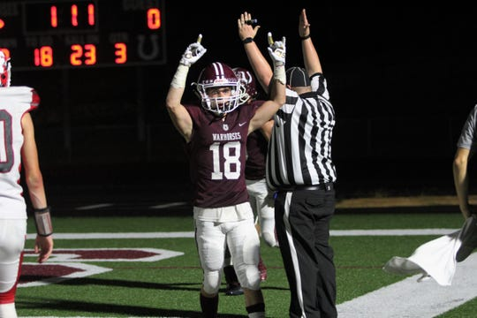 Owen senior Zebulan Lord celebrates a Warhorse touchdown in a 44-7 win over Franklin on Sept. 27.