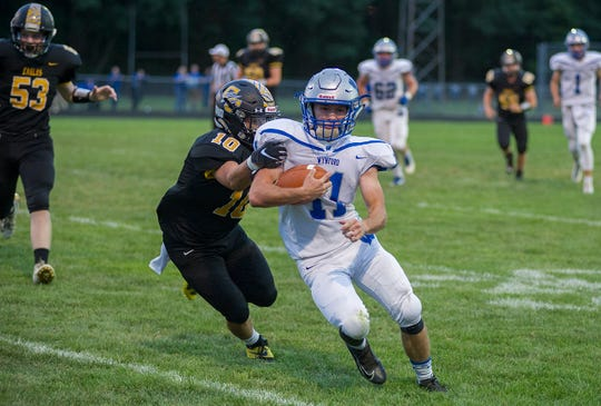 Colonel Crawford's Seth Carman tries to tackle Wynford's Cody Taylor.
