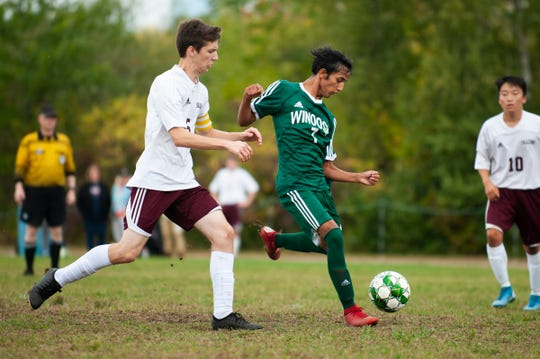 Winooski's Lek Nath Luitel (7) takes a shot during the boys soccer game between the Richford Falcons and the Winooski Spartans at Winooski High School on Saturday afternoon September 28, 2019 in Winooski, Vermont.
