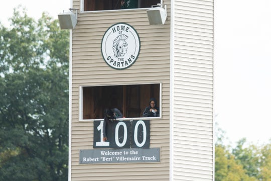 Fans change the sign in the press box to 100 after Winooski's Lek Nath Luitel (not pictured) scored his 100th goal during the boys soccer game between the Richford Falcons and the Winooski Spartans at Winooski High School on Saturday afternoon September 28, 2019 in Winooski, Vermont.