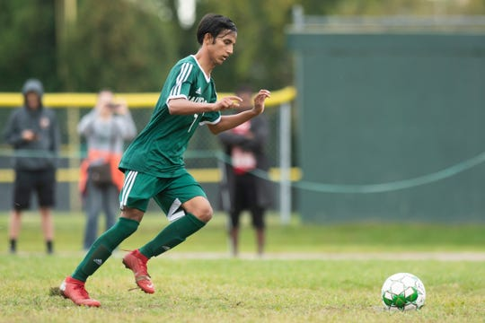 Winooski's Lek Nath Luitel (7) kicks a penaly kick during the boys soccer game between the Richford Falcons and the Winooski Spartans at Winooski High School on Saturday afternoon September 28, 2019 in Winooski, Vermont.