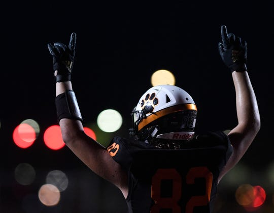 Refugio's Hayden LaFrance points to the sky after a touchdown against Mart, Friday, Sept. 27, 2019, in Refugio. Refugio won, 48-40.