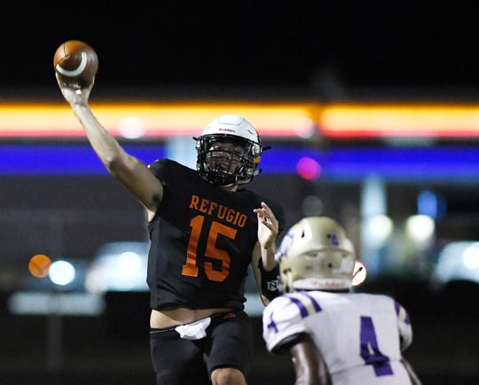 Refugio's quarterback Austin Ochoa prepares to throw a pass at the game against Mart, Friday, Sept. 27, 2019, in Refugio. This is the first win in program history against Mart.