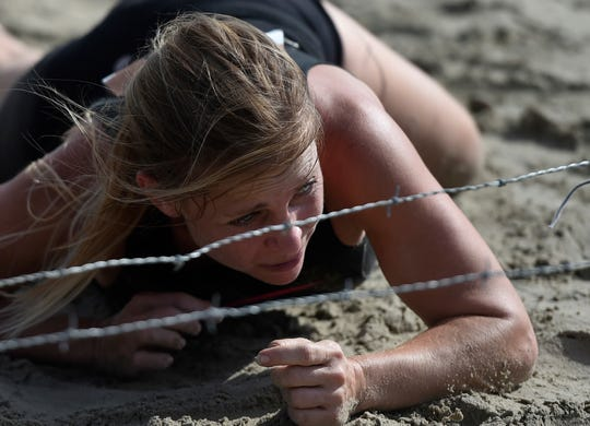 The Port Aransas Jail Break Escape is a 5-kilometer run that features 20 challenging obstacles such as a tall wall, tire guard, cargo net, pole carry, and rope wall on Saturday, Sept. 28, 2019, at Horace Caldwell Pier. The race took place on the beach.