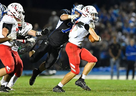 Williamstown's Aaron Lewis sacks Brady Long during Friday night's football game against Lenape at Williamstown High School. The Braves topped the Indians, 28 - 21, on Sept. 27, 2019.