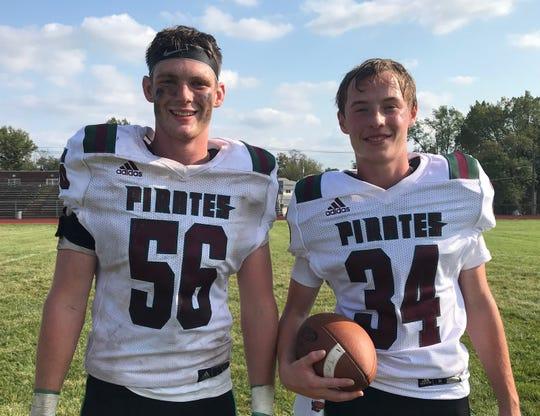 Cedar Creek's Tyler Hendrickson (left) and Taylor Manning