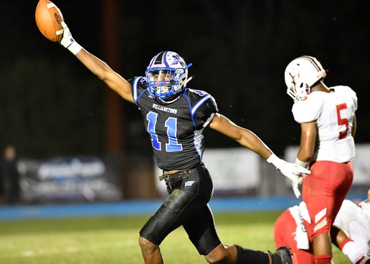 Williamstown's Donovan Ezeiruaku recovers a fumble during Friday night's football game against visiting Lenape. The Braves topped the Indians, 28-21, on Sept. 27, 2019.