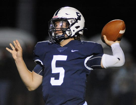 Shawnee quarterback Matt Welsey throws a pass during Friday night's football game against St. Augustine at Shawnee High School, Sept. 27, 2019.