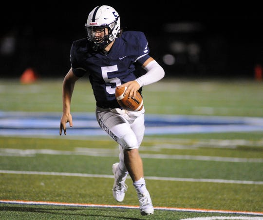Shawnee quarterback Matt Welsey carries the ball during Friday night's football game against St. Augustine at Shawnee High School, Sept. 27, 2019.
